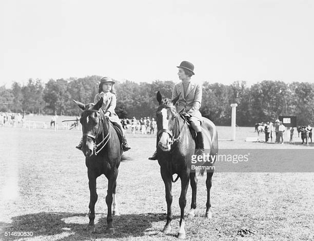 9/1/35Smithtown Long Island Mrs John Bouvier 3rd society equestrienne is pictured with her daughter Jacqueline in the parent and child class of the...