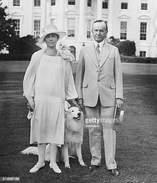 Washington, DC: Above is the first picture to be taken of the President and Mrs. Coolidge on the lawn of the nely decorated White House, which was...
