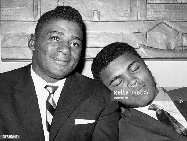 New York, NY- World heavyweight champion Cassius Clay naps on the shoulder of former champion Floyd Patterson during a September 14th press...