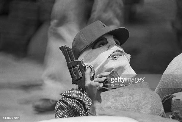9/14/1978Leon Nicaragua A Sandinista guerilla looks skyward as National Guard planes pelt Leon with machine gun fire in an effort to rout leftist...