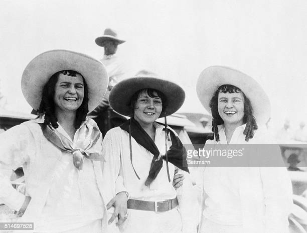 9/15/1927Fort Worth TX These cowgirls like curls They are triplets Elean Conie and Elsie Robertson Conie is in the center with bobbed hair the other...