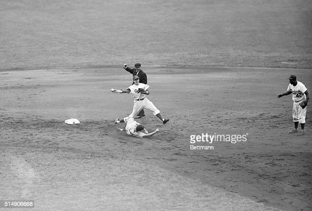 9/15/1952New York NY Cincinnati's Johnny Temple slides into second base and is forced out by Dodger shortstop Pee Wee Reese who took the throw from...