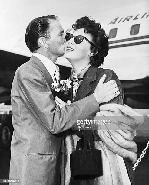 9/15/1952New York NY Crooner Frank Sinatra currently appearing at a local nightclub greets his wife Ava Gardner on her arrival by plane at Idlewild...