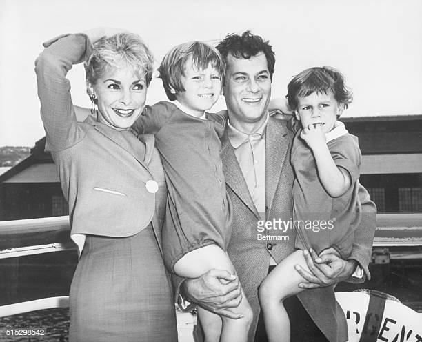 New York, New York- Tony Curtis and Janet Leigh with their children, Kelly and Jamie, 2 1/2, pose prettily prior to their departure on the...