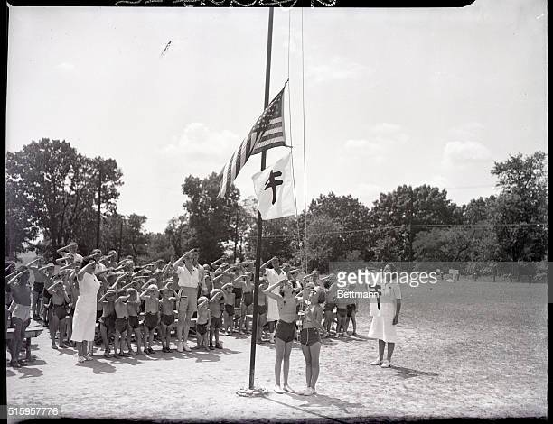 9/15/38After a happy healthful day in camp the boys and girls march to the parade grounds and the colors are lowered as the bugler sounds retreat The...