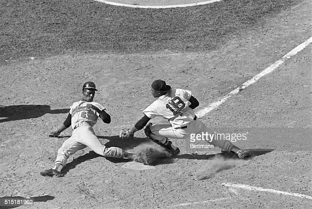 9/16/1967Boston MA Baltimore Orioles' Paul Blair is safe at home plate scoring from second base on a single hit by Frank Robinson to Bosox center...