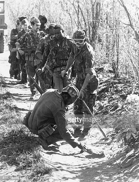 9/16/1973Estima Mozambique Portuguese troops on patrol in the Tete region of Mozambique uncover a land mine laid by guerrillas as the 9yearold fight...