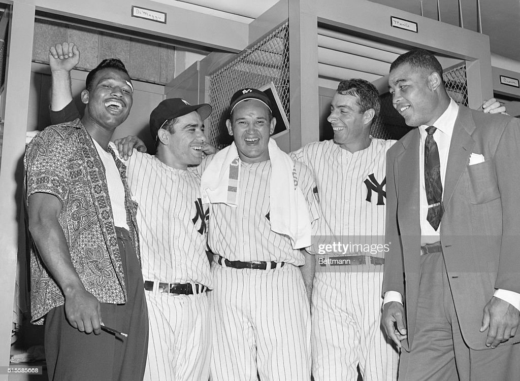 The Yankees, in a hard fight for the pennant, were visited by a couple of fighters in the dressing room after their important 5-1 victory over the Indians at the Yankee Stadium Sept. 16. Both Sugar Ray Robinson (left), who recently won back middleweight crown; and former heavyweight champion Joe Louis (right) witnessed the game, which the Yanks won to lead the Indians by percentage points. The ball players are (left to right) catcher Yogi Berrra; Allie Reynolds, who pitched a sparkling game for his 15th victory, and outfielder Joe DiMaggio. Berra and DiMaggio socked triples to knock in runs.
