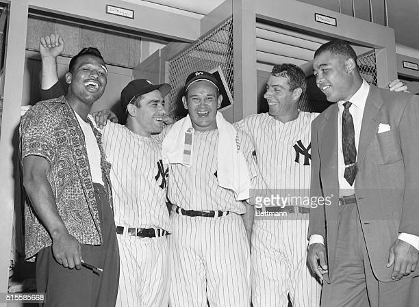 The Yankees in a hard fight for the pennant were visited by a couple of fighters in the dressing room after their important 51 victory over the...
