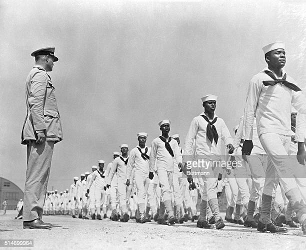 9/17/1942Great Lakes IL Converted from civilians into trim snappy sailors within a few weeks this company of Negro recruits passes in review before...