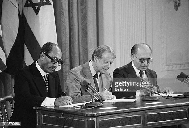 Washington, DC: President Anwar Sadat of Egypt, President Carter and Israeli Prime Minister Menachem Begin sign two agreements providing for...