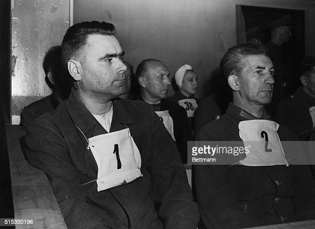 """Luneburg, Germany-Joseph Kramer, """"no.1"""" Commandant of the Belsen concentration camp and Fritz Klein, """"no.2,"""" the camp doctor, sit in the dock before..."""