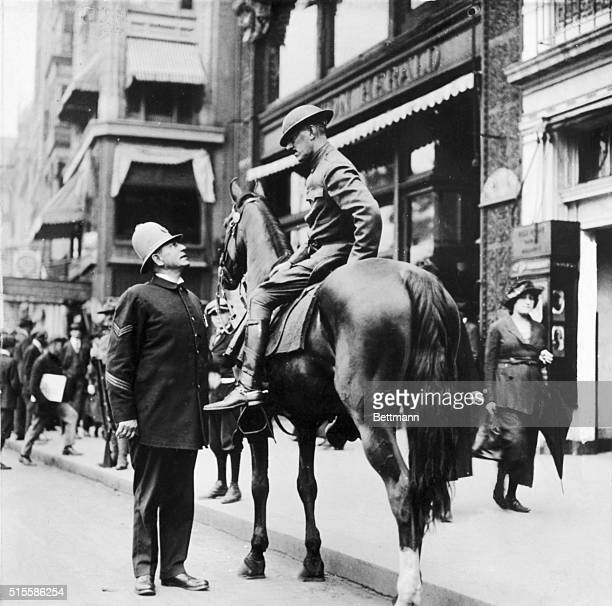 9/1919Boston Massachusetts One of the few policemen who remain on duty during the Boston police strike This officer speaks to a member of the...