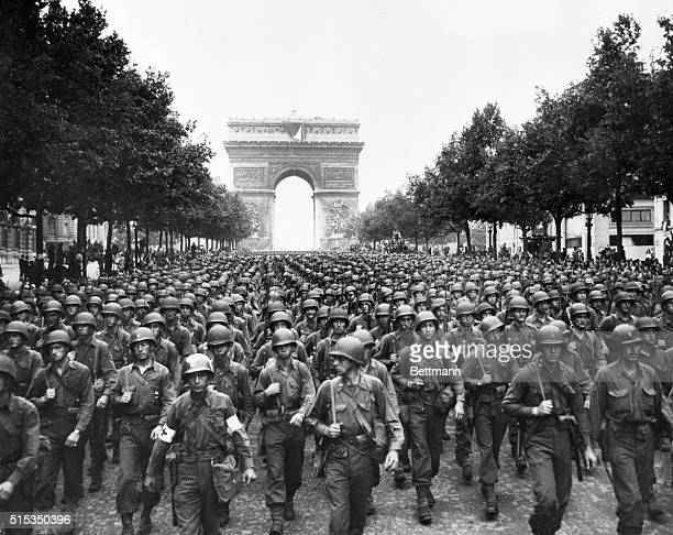 View of US troops marching down the Champs Elysees with the Arc de Triomphe in background BPA2