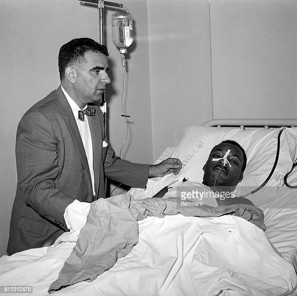 9/20/1958New York NY Dr Emil A Naclerio stands at the bedside of negro leader Rev Martin Luther King in Harlem Hospital here Sept 21st after a 3 hour...
