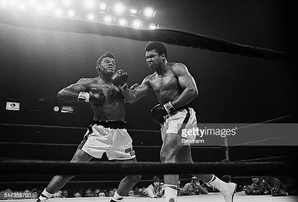 New York, NY-: Muhammad Ali lands a punch right on the button during the sixth round of his bout with Floyd Patterson at Madison Square Garden.