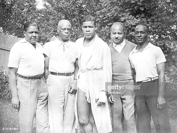 Pompton Lakes, NJ- Here is Joe Louis, of Detroit and environs, and the men who are directing him along the path to pugilistic fame- left to right -:...