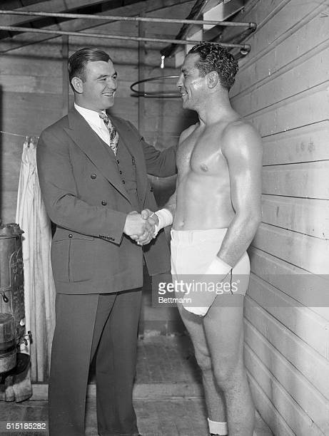 9/21/1935Speculator NY Jimmy Braddock the new heavyweight champion of the world shakes hands with Max Baer the former champion to wish him luck for...