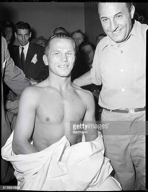 9/21/1948Jersey City NJ Tony Zale the 'Man of Steel' from Gary Indiana manages a weak grin as he sits in his dressing room at Roosevelt Stadium after...