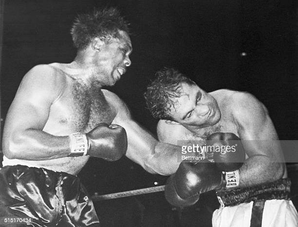 9/21/1955New York NY Challenger Archie Moore lands a left to the jaw of heavyweight king Rocky Marciano in the second round of their title go at...