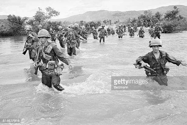 9/21/1965Ben Khe South Vietnam Some manouvers get wet for the soldiers in South Viet Nam During a sweeping operation in Ben Khe members of the United...