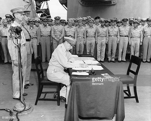 9/2/1945Tokyo Bay Japan The General of the Army Douglas MacArthur signs as the Supreme Allied Commander during a formal ceremony on the USS Missouri...