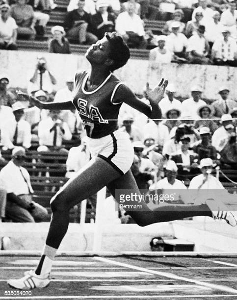 Rome, Italy- America's Wilma Rudolph, of Clarksville, TN, breaks the tape to win her semi-final heat in the women's 100-meter dash. Wilma won in the...