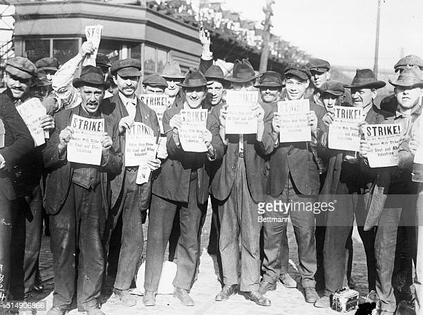 Chicago, IL-ORIGINAL CAPTION READS: Steel strike at Illinois Steel Mills, Chicago. Photo shows strikers holding bulletins concerning a nation-wide...