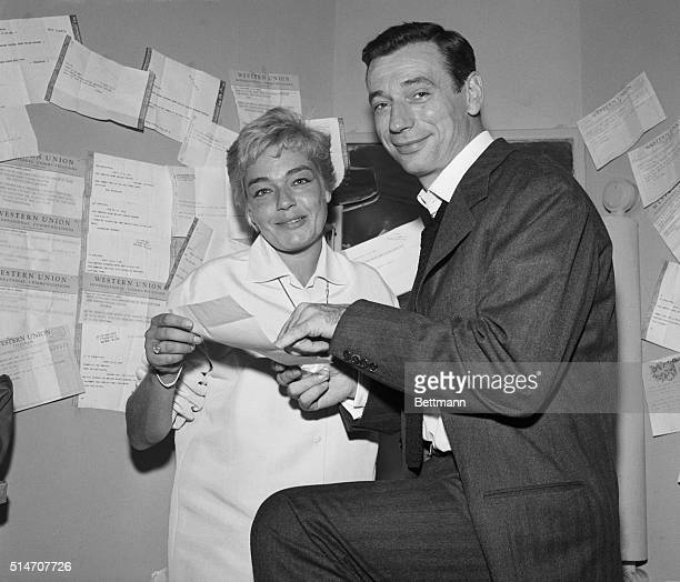 9/22/1959New York NY Telegrams decorate the walls in the dressing room of popular French entertainer Yves Montand as he and his wife actress Simone...