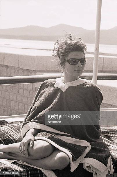 9/22/1964Sardinia Italy Wrapped in a terrycloth poncho robe Soraya the former Empress of Iran sits pensively waiting for the cameras to roll for a...