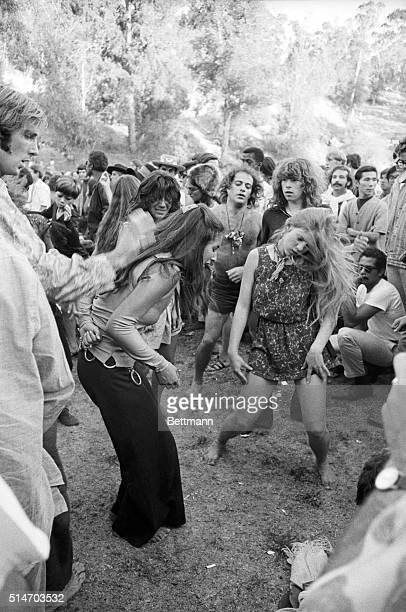 """Los Angeles: A couple of girls do a dance at a """"love-in"""" held at Elysian Park 9/22. Outbreaks of violence were reported as a crowd of nearly 7,000..."""