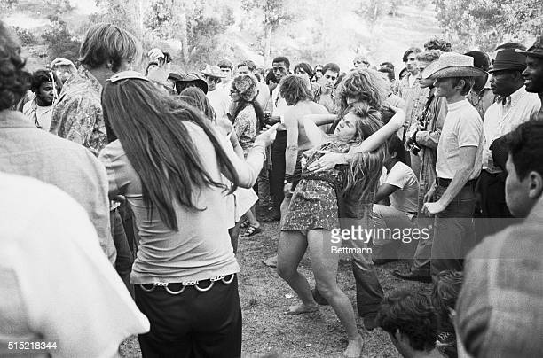 """Los Angeles, California- A couple of girls do a dance at a """"love-in"""" held at Elysian Park 9/22. Out breaks of violence were reported as a crowd of..."""
