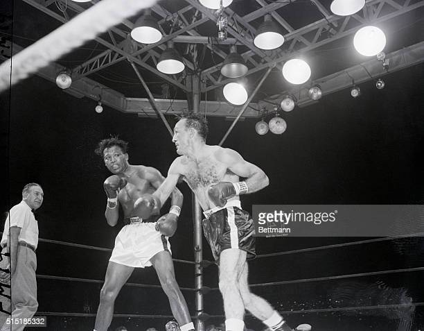 9/23/1957New York NY Turn about is fair play according to Carmen Basilio as he follows through after landing a hard right to the jaw of Sugar Ray...