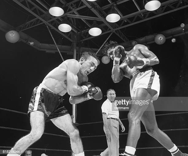 9/23/1957New York NY Yankee Stadium His eyes closed Carmen Basilio winces with pain from terrific right of their bout tonight Following through Sugar...