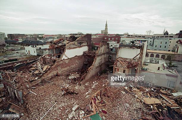 9/23/89Charleston South Carolina Storekeepers survey extensive damage from roof caused by Hurricane Hugo as it slammed into Charleston Carriage...