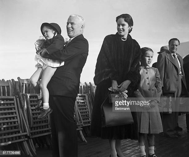 9/24/1952Southampton England Back in his native for the first time in 21 years movie comedian Charles Chaplin is shown holding up his daughter...