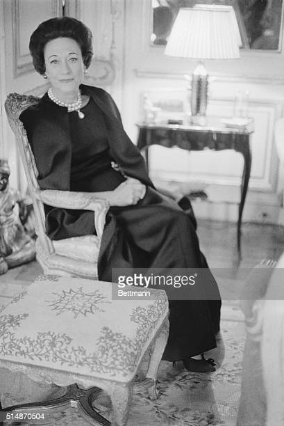9/24/1965Paris France Sitting in her Paris home the Duchess of Windsor wears Givenchy's long dress and cape ensemble of black satin The Dutchess who...