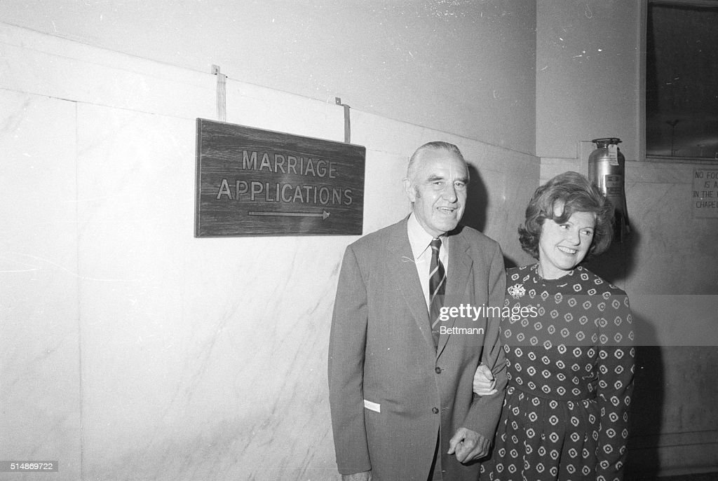 Former Ambassador Averell Harriman, 79, and Mrs. Pamela Digby Churchill Hayward, 51 year old widow of Broadway producer Leland Hayward, leave the New York Municipal Building after filing for a marriage license, Sept. 24th.