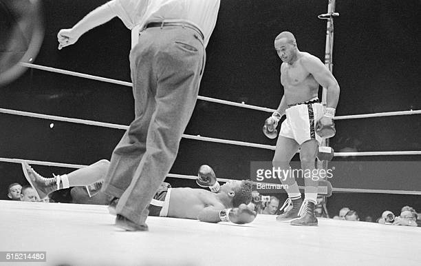 9/25/1962Comisky Park Chicago IL Sonny Liston watches as Floyd Patterson falls to the canvas after being hit by a hard left hook in the first round...