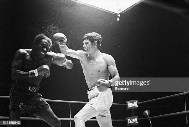 Buenos Aires, Argentina- Perspiration sprays from the head of Emile Griffith of the USA, as Carlos Monzon of Argentina lands a hard right in the...