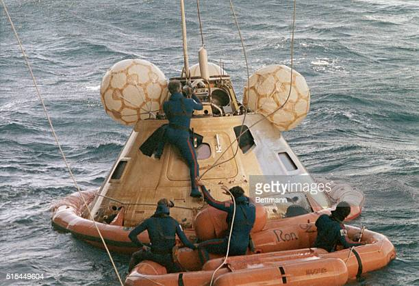9/25/1973Pacific Ocean Navy scuba divers place a floatation collar around the Skylab III spacecraft inside which astronauts Alan L Bean Owen K...