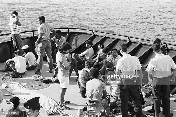 9/25/1986Miami Beach FLSome of the 37 Dominican refugees taken from a sailboat off the Florida Keys show their exhastion as they wait on the deck of...