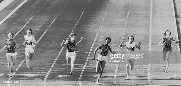 Rome, Italy: America's Wilma Rudolph breasts the tape to win the women's 100-meter dash here, Sept. 2nd. Wilma's winning time was 11seconds flat, a...