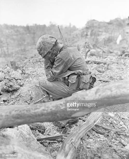 9/26/1944Peleliu Island Weary and exhausted after the tough battle for Hill 200 Near Peleliu Airpoet this leathr neck sits down amidst the battle...
