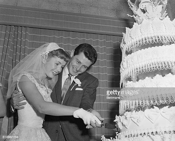 9/26/1955Liberty NY Actress Debbie Reynolds and singer Eddie Fisher cut their towering wedding cake after they were married at Liberty NY Their much...