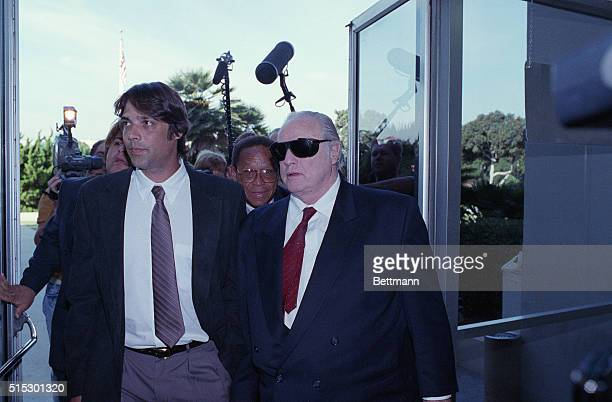 Santa Monica, California-: Actor Marlon Brando , accompanies his son, Christian , into Superior Court for a pre-trial hearing on charges that...