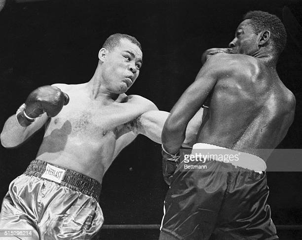 New York, NY-: As Ezzard Charles backs away, Joe Louis lands a left during their 15-round bout at the Yankee Stadium tonight.