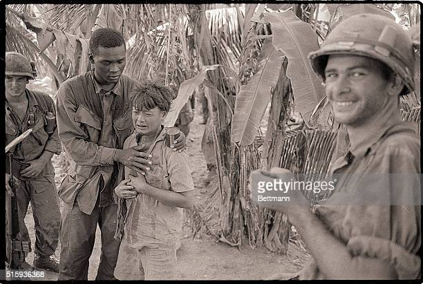 9/27/1968Soc Trang South Vietnam A member of the US 9th infantry comforts a youthful Viet Cong suspect picked up during a sweep near Soc Trang 70...