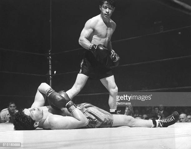 New York, NY- Rocky Graziano stands over Harold Green after knocking him down in the third round. Referee Ruby Goldstein had counted the final number...