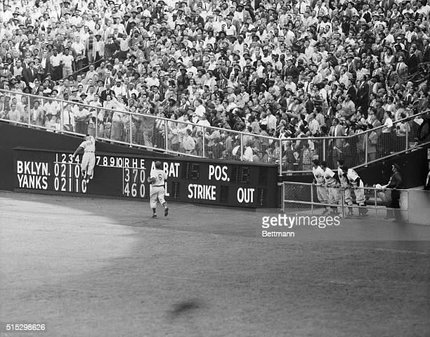 9/28/1955New York New York Dodger centerfielder Duke Snider leaps in vain for Yankee Joe Collins' homer in the sixth inning of the World Series at...